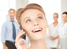 Businesswoman with cell phone calling Royalty Free Stock Photography
