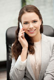 Businesswoman with cell phone calling Stock Photo