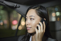 Businesswoman With Cell Phone In Car Back Royalty Free Stock Photos