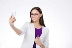 Businesswoman with cell phone Royalty Free Stock Image