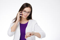 Businesswoman with cell phone Royalty Free Stock Images