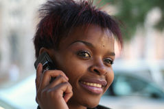 Businesswoman and cellphone Royalty Free Stock Photo