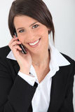 Businesswoman with a cellphone Royalty Free Stock Image