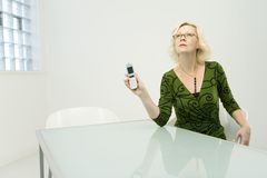 Businesswoman with cellphone Stock Images