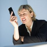 Businesswoman with cellphone. Stock Images