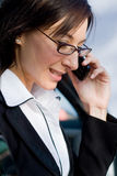 Businesswoman on cellphone Stock Images