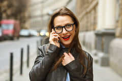Businesswoman on cellphone walking down the street while talking Stock Images