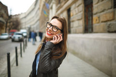 Businesswoman on cellphone walking down the street while talking Royalty Free Stock Image
