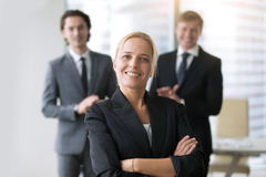 Businesswoman in center of group Royalty Free Stock Images
