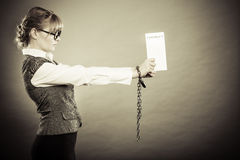 Businesswoman with chained hands holding contract Royalty Free Stock Photos