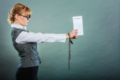 Businesswoman with chained hands holding contract Royalty Free Stock Photography