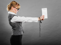 Businesswoman with chained hands holding contract Stock Photo