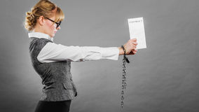 Businesswoman with chained hands holding contract Royalty Free Stock Images