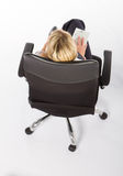 Businesswoman in chair Stock Photography