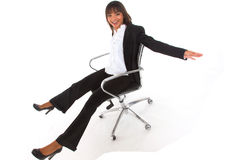 Businesswoman on a chair Royalty Free Stock Photos