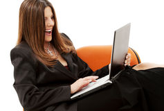 Businesswoman in chair with laptop Royalty Free Stock Photos