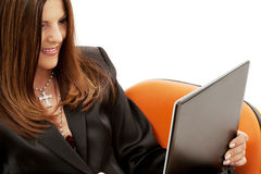 Businesswoman in chair with laptop Royalty Free Stock Image