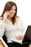 Businesswoman in chair with laptop and phone Stock Photos