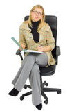 Businesswoman in a chair with paperwork royalty free stock photo