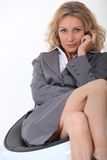Businesswoman on chair Royalty Free Stock Images