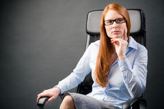 Businesswoman in a Chair Thinking Royalty Free Stock Image