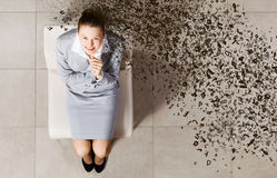 Businesswoman on chair Stock Photography