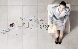 Businesswoman on chair Stock Photo