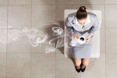 Businesswoman on chair Stock Images