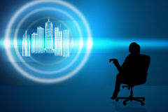 Businesswoman in chair with virtual city Stock Photography