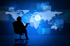 Businesswoman in chair with world map Stock Image