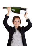 Businesswoman and champagne bottle Royalty Free Stock Photos