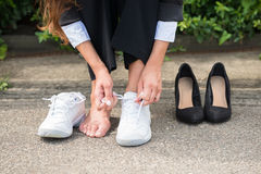 Businesswoman Changing Shoes Stock Images
