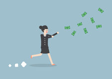 Businesswoman chasing falling dollar bills Royalty Free Stock Photo