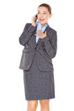 Businesswoman chatting on her mobile phone Royalty Free Stock Images
