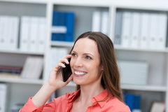 Businesswoman chatting on a smartphone Royalty Free Stock Image
