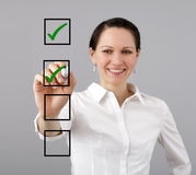 Businesswoman and check list. Businesswoman with a marker and check list Royalty Free Stock Photo