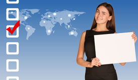 Businesswoman with checkboxes and world map. Businesswoman hold white paper. Checkboxes and world map as backdrop Royalty Free Stock Photos
