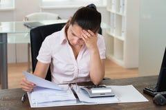 Businesswoman Checking Bills Royalty Free Stock Image