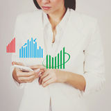 Businesswoman checking charts on smart phone. Young Caucasian businesswoman checking charts on smart phone. Abstract concept Royalty Free Stock Image