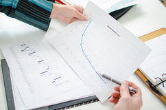 Businesswoman checking a financial curve Royalty Free Stock Photos
