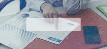 Businesswoman checking financial reports and business icons royalty free stock photo