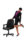 Businesswoman checking her heels Royalty Free Stock Photo