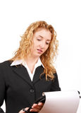 Businesswoman checking her notepad over Stock Images