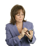 Businesswoman Checking Her PDA Royalty Free Stock Photography