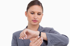 Businesswoman checking her watch Royalty Free Stock Photography