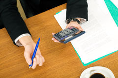 Businesswoman checking the numbers Stock Photos