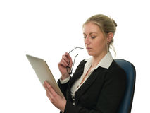 Businesswoman checking reports on tablet computer Stock Images