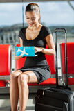 Businesswoman checking ticket Stock Photography