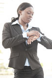Businesswoman checking the time Stock Photo