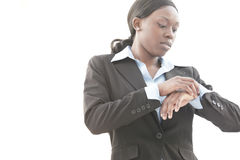 Businesswoman checking the time Stock Image
